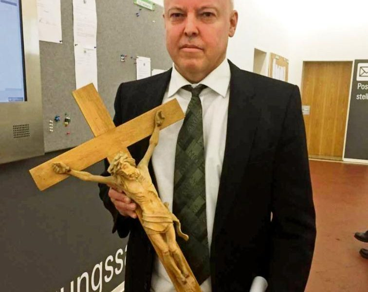 A German judge removes cross during trial of Afghan migrant, faces backlash