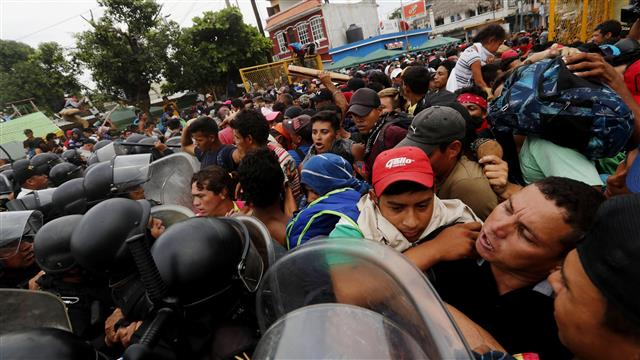 Migrants In Caravan Shooting Guns At Cops